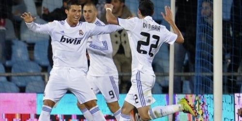 Real Madrid gana con doblete de Ronaldo y sigue al Barça